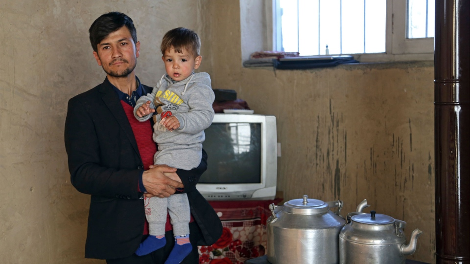 Asadullah Poya with his 18-month-old son Donald Trump, poses for a photograph at their rented house in Kabul, Afghanistan, Thursday, March 15, 2018. Poya, from a small, rural village, named his newborn son Donald Trump, hoping it would bring the boy good fortune. It hasn't. Relatives and neighbors were furious that he broke with tradition and gave his son a non-Muslim name. He was forced to move his family to Kabul, and they've received death threats online. (AP Photo/Rahmat Gul)