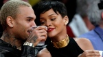 Entertainers Chris Brown, left, and Rihanna attend an NBA basketball game between the Los Angeles Lakers and New York Knicks in Los Angeles, Tuesday, Dec. 25, 2012. The Lakers won 100-94. (AP Photo/Alex Gallardo)