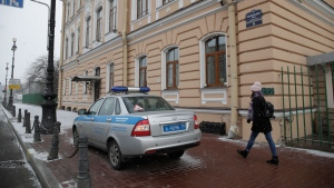A police car is parked at the British Consulate General, in St. Petersburg, Russia, Saturday, March 17, 2018. (AP Photo/Dmitri Lovetsky)