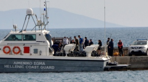 A coast guard vessel arrives with the bodies of migrants at the port of Pythagorio on the eastern Greek island of Samos, Saturday, March 17, 2018. Greece's coast guard said Saturday the bodies of fourteen people have been recovered from the sea off a Greek island in the eastern Aegean following the sinking of a suspected migrant smuggling boat. (AP Photo/Michael Svarnias)