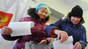 People cast their ballots at a polling station in Yelizovo, about 30 kilometers ( 19 miles) north-east from Petropavlovsk-Kamchatsky, capital of Kamchatka Peninsula region, Russian Far East, Russia, on Sunday, March. 18, 2018. Polls have opened in Russia's Far East for the presidential election in which Vladimir Putin seeks a 4th term. (AP Photo/Alexander Petpov)
