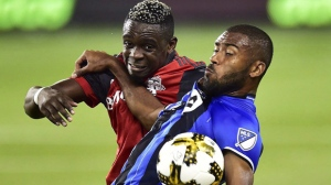 Montreal Impact forward Anthony Jackson-Hamel, right, battles for the ball with Toronto FC defender Chris Mavinga during first half MLS soccer action in Toronto on Wednesday, September 20, 2017. The Montreal Impact are searching for reinforcements after dropping their first two games of the Major League Soccer season, but no help is expected in time for their showdown Saturday with rival Toronto FC.THE CANADIAN PRESS/Frank Gunn
