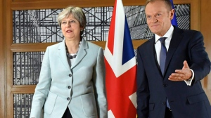 In this Dec. 8, 2017 file photo, British Prime Minister Theresa May, left, walks with European Council President Donald Tusk in Brussels. European Council President Donald Tusk unveiled on Wednesday, March 7, 2018, the EU's approach to the next phase of Brexit talks on future relations with the UK. (AP Photo/Geert Vanden Wijngaert, File)