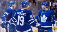 Toronto Maple Leafs Kasperi Kapanen (left) celebrates with teammates (left to right) Tomas Plekanec, Connor Carrick and Travis Dermott after scoring Leafs' second goal against the Montreal Canadiens during second period NHL hockey action in Toronto on Saturday, March 17 , 2018.THE CANADIAN PRESS/Chris Young