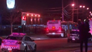 Emergency vehicles are seen on Samor Road, outside Playtime Bowl, after a shooting on March 17 that left one man dead and another woman critically injured. (CP24)
