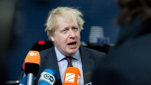 British Foreign Secretary Boris Johnson speaks with the media as he arrives for a meeting of EU foreign ministers at the Europa building in Brussels on Monday, March 19, 2018. (AP Photo/Virginia Mayo)