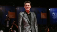 In this Sept. 5, 2017, file photo, actor Jim Carrey poses for photographers at the premiere of the film 'Jim and Andy: The Great Beyond' at the 74th edition of the Venice Film Festival in Venice, Italy.  (Photo by Joel Ryan/Invision/AP, File)