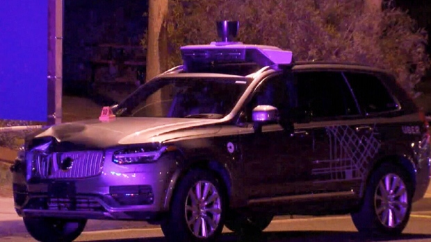 Uber suspends self-driving car tests after deadly pedestrian accident
