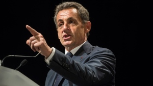In this Wednesday, Nov. 9, 2016 file photo, former French President and candidate for France's conservative presidential primary Nicolas Sarkozy delivers a speech during a campaign meeting in Meyzieu, near Lyon, central France. (AP Photo/Laurent Cipriani, File)