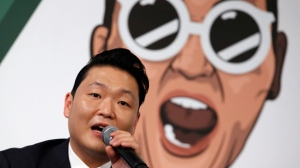 In this Nov. 30, 2015 file photo, South Korean singer PSY answers a reporter's question during a news conference on the release of his seventh album in Seoul, South Korea.  (AP Photo/Lee Jin-man, File)