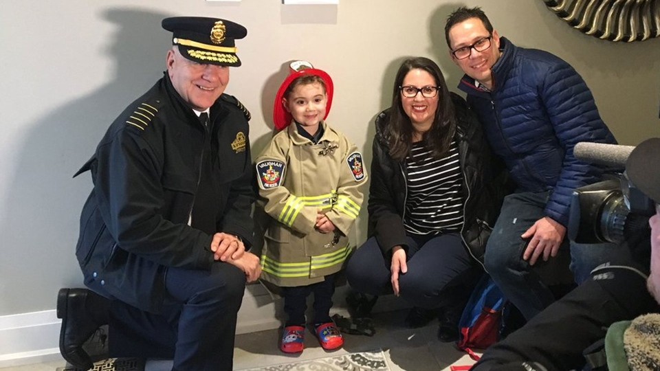 Matteo Papa and his parents pose with Vaughan Fire Chief Larry Bentley after the chief made Matteo an honourary firefighter for his fifth birthday. (@VaughanFire /Twitter)