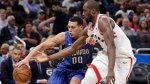 Orlando Magic's Aaron Gordon (00) tries to get around Toronto Raptors' Serge Ibaka during the second half of an NBA basketball game, Tuesday, March 20, 2018, in Orlando, Fla. (AP Photo/John Raoux)