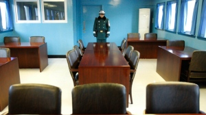 In this Dec. 22, 2011, file photo, a South Korean soldier stands on guard in a conference room at the border village of Panmunjom in the demilitarized zone (DMZ) in South Korea. With no official word, speculation heats up over where unprecedented summit between U.S. President Donald Trump and North Korean leader Kim Jong Un will be held. DMZ is a symbol of the division of Korea 70 years ago into the socialist North and the capitalist South. (AP Photo/Wally Santana, File)