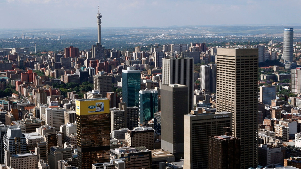 "In this Oct. 18, 2009, file photo, Johannesburg is seen from the sky. The blockbuster film ""Black Panther"" has created a new compelling vision of Africa as a continent of smart, technologically savvy people with cool clothes living in a futuristic city amid stunning landscapes. (AP Photo/Themba Hadebe, File)"