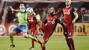 Toronto FC midfielder Victor Vazquez (7) plays the ball as Seattle Sounders midfielder Nicolas Lodeiro (10) defends and Toronto FC midfielder Michael Bradley (4) looks on during second half MLS Cup Final soccer action in Toronto on Saturday, December 9, 2017. oronto FC has re-signed Spanish playmaker Victor Vazquez to a multi-year contract extension. THE CANADIAN PRESS/ Nathan Denette