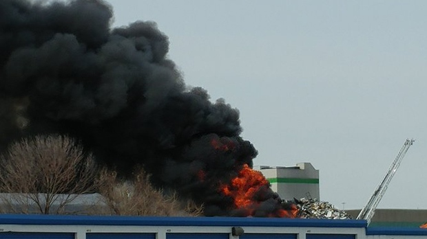 A plume of thick smoke is seen in Burlington after a pile of scrap metal caught fire. (Twitter/@AskGoo)