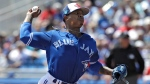 Toronto Blue Jays' Marcus Stroman pitches to the Philadelphia Phillies during the first inning of a spring training baseball game, Wednesday, March 21, 2018, in Dunedin, Fla. (AP Photo/Chris O'Meara)