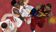 Toronto Raptors' Jakob Poeltl, left, and Pascal Siakam defend against Cleveland Cavaliers' LeBron James during the first half of an NBA basketball game Wednesday, March 21, 2018, in Cleveland. (AP Photo/Tony Dejak)