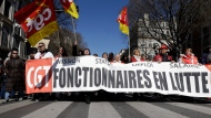"Civil servants march with a banner of the CGT union (General Work Confederation) reading ""Civil servants fighting"" during a demonstration in Marseille, southern France, Thursday, March 22, 2018. Nationwide strikes are causing major disruptions to trains, planes, schools and other public services in France Thursday as unions set up dozens of street protests across the country. (AP Photo/Claude Paris)"