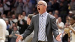 In this Feb. 13, 2018, file photo, Rhode Island head coach Dan Hurley tries to pump up the crowd after his team went on a run during the second half of an NCAA college basketball game against Richmond, in Kingston, R.I. Rhode Island head basketball coach Dan Hurley has agreed to become the head coach at the University of Connecticut. Hurley replaces Kevin Ollie, who was fired earlier this month. UConn made the announcement Thursday morning, March 22, 2018, in a Tweet.(AP Photo/Stew Milne, File)
