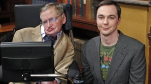 "In this March 9, 2012 photo released by CBS, famed British physicist Stephen Hawking, left, appears with Jim Parsons, who plays Sheldon Cooper, during the taping of an episode of the comedy series ""The Big Bang Theory,"" in Los Angeles. In the episode titled ""The Hawking Excitation"", airing Thursday, April 5, at 8 p.m. EST on CBS, Hawking will stop by the University to share his beautiful mind with his most ardent admirer, Sheldon Cooper. (AP Photo/CBS, Sonja Flemming)"