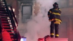 This photo provided by WPIX-11 shows New York Firefighters at the scene of a raging fire at an unoccupied residential building being used as a film set in the Harlem section of New York on Thursday, March 22, 2018.  Firefighter Michael R. Davidson of Engine Company 69 was killed after getting separated from other firefighters inside the building as conditions deteriorated and had lost consciousness when he was found by fellow firefighters. He was pronounced dead at a hospital. (WPIX-11 via AP)
