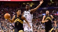 Toronto Raptors guard Kyle Lowry (7) drives to the net against Brooklyn Nets guard Caris LeVert (22) during second half NBA basketball action in Toronto on Friday, March 23, 2018. THE CANADIAN PRESS/Frank Gunn