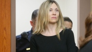 This Feb. 14, 2013 file photo shows Amy Locane Bovenizer entering the courtroom to be sentenced in Somerville, N.J. for the 2010 drunk driving accident in Montgomery Township that killed 60-year-old Helene Seeman The actress, who served about two-and-a-half years of a three-year sentence, must return to court for a second re-sentencing. (AP Photo/The Star-Ledger, Patti Sapone, File)