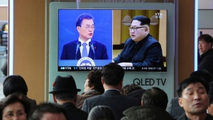 In this March 7, 2018, file photo, people watch a TV screen showing images of North Korean leader Kim Jong Un and South Korean President Moon Jae-in, left, at the Seoul Railway Station in Seoul, South Korea. (AP Photo/Ahn Young-joon, File)