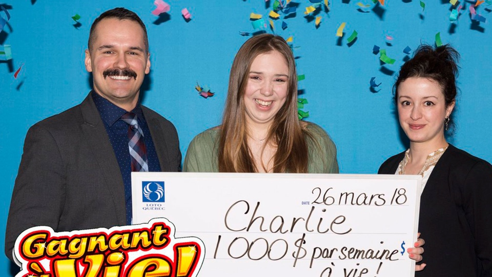 Quebec teen Charlie Lagarde holds a giant cheque after winning the grand prize in the Gagnant a Vie lottery. (Handout /Loto Quebec)