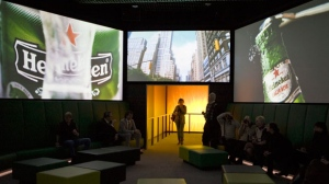 In this Dec. 9, 2008, file photo, visitors watch Heineken commercials on large screens at the Heineken Experience, Amsterdam. (AP Photo/Peter Dejong, File)