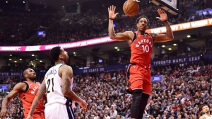 Toronto Raptors guard DeMar DeRozan (10) scores as Denver Nuggets forward Wilson Chandler (21) looks on during first half NBA basketball action in Toronto on Tuesday, March 27, 2018. THE CANADIAN PRESS/Frank Gunn