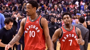 Toronto Raptors guard DeMar DeRozan (10) and Guard Kyle Lowry walk off the court after losing to the Los Angeles Clippers in NBA basketball action in Toronto on Sunday, March 25, 2018. THE CANADIAN PRESS/Frank Gunn