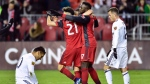 Toronto FC forward Jozy Altidore (17) celebrates his second goal of the match with teammate Jonathan Osorio (21) during first half MLS soccer action against the Real Salt Lake, in Toronto, Friday, March 30, 2018. THE CANADIAN PRESS/Frank Gunn