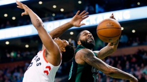 Boston Celtics' Marcus Morris (13) blocks a shot by Toronto Raptors' Kyle Lowry during the fourth quarter of an NBA basketball game in Boston, Saturday, March 31, 2018. The Celtics won 110-99. (AP Photo/Michael Dwyer)