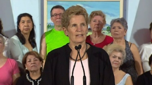 Premier Kathleen Wynne speaks to reporters on April 3, 2018.