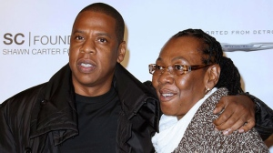"""In this Sept. 29, 2011 file photo released by Starpix, Shawn """"Jay Z"""" Carter poses with his mother Gloria Carter at a fundraising event to support his college scholarship program in New York.  (AP Photo/Starpix, Kristina Bumphrey, File)"""