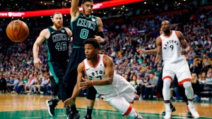 Toronto Raptors' Kyle Lowry (7) passes off in front of Boston Celtics' Jayson Tatum (0) during the third quarter of an NBA basketball game in Boston, Saturday, March 31, 2018. The Celtics won 110-99. (AP Photo/Michael Dwyer)