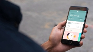 A Wealthsimple program is shown on a cell phone. (Wealthsimple / THE CANADIAN PRESS)