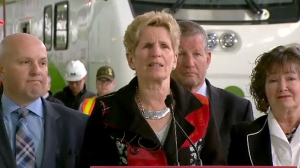 Premier Katheen Wynne speaks to reporters on April 5, 2018.
