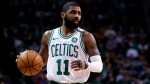In this Feb. 28, 2018, file photo, Boston Celtics guard Kyrie Irving (11) moves down court during the first quarter of an NBA basketball game in Boston. (AP Photo/Charles Krupa)
