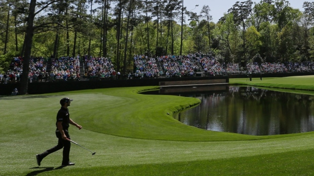McIlroy, Kuchar share Masters lead after Spieth horror start