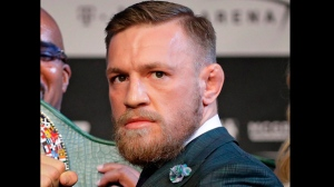In this Aug. 23, 2017, file photo, Ultimate Fighting star Conor McGregor poses during a news conference in Las Vegas. McGregor is facing criminal charges in the wake of a backstage melee he allegedly instigated that has forced the removal of three fights from UFC's biggest card of the year. Video footage appears to show the promotion's most bankable star throwing a hand truck at a bus full of fighters after a Thursday, April 5, 2018, news conference for UFC 223 at Brooklyn's Barclays Center. (AP Photo/John Locher, File)