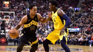 Toronto Raptors guard DeMar DeRozan (10) moves past Indiana Pacers guard Victor Oladipo (4) during first half NBA basketball action in Toronto on Friday, April 6, 2018. THE CANADIAN PRESS/Frank Gunn