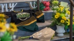 A memorial at the stairs that lead to Elgar Petersen Arena is shown in Humboldt, Sask., on Saturday, April 7, 2018. THE CANADIAN PRESS/Liam Richards