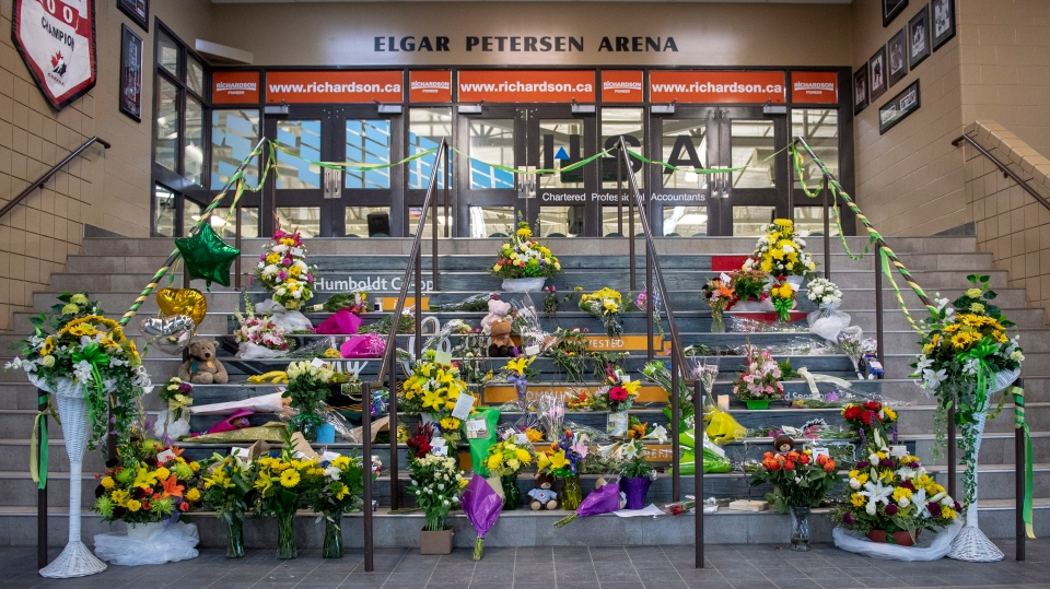 A memorial sits at the stairs that lead to Elgar Petersen Arena in Humboldt, Sask., on Sunday, April 8, 2018.  THE CANADIAN PRESS/Liam Richards
