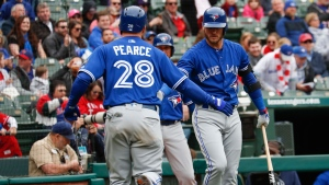 Toronto Blue Jays' Steve Pearce (28) is congratulated by Josh Donaldson, right, as he arrives after hitting a home run off the first pitch thrown by Texas Rangers starting pitcher Cole Hamels during the first inning of a baseball game, Sunday, April 8, 2018, in Arlington, Texas. (AP Photo/Jim Cowsert)