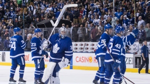 Toronto Maple Leafs goaltender Frederik Andersen (centre) raises his stick to acknowledge fans as the Maple Leafs leave the ice after defeating the Montreal Canadiens in NHL hockey action in Toronto, on Saturday, April 7, 2018. THE CANADIAN PRESS/Chris Young