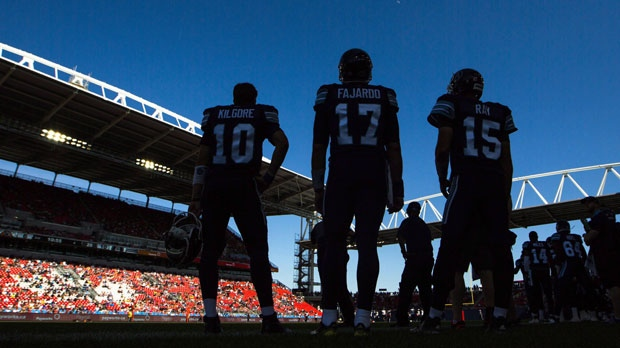 Players stand on the sidelines as the Toronto Argonauts play the Hamilton Tiger-Cats during the first half of CFL football preseason action, at the first ever CFL football game played at BMO Field, in Toronto on June 11, 2016.  THE CANADIAN PRESS/Mark Blinch