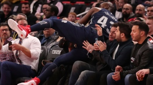 Detroit Pistons forward Anthony Tolliver falls into the seats after chasing the ball during the first half of an NBA basketball game against the Toronto Raptors, Monday, April 9, 2018, in Detroit. (AP Photo/Carlos Osorio)